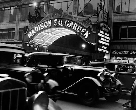 1920s 1930s CARS TAXI MADISON SQUARE GARDEN MARQUEE AT NIGHT HOCKEY NEW YORK CITY NYC LIGGETT DRUGSTORE MANHATTAN NY Stock Photo - Rights-Managed, Code: 846-02796483