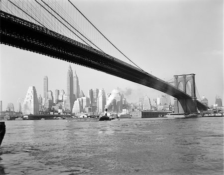 1950s SKYLINE OF LOWER MANHATTAN WITH BROOKLYN BRIDGE FROM BROOKLYN ACROSS THE EAST RIVER Stock Photo - Rights-Managed, Code: 846-02796549