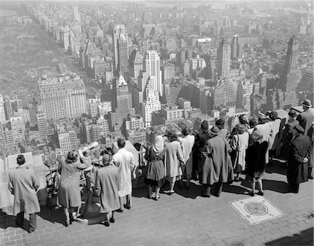 1940s GROUP OF TOURISTS STANDING ON TOP OF RCA BUILDING LOOKING OUT OVER CITY Stock Photo - Rights-Managed, Code: 846-02796659