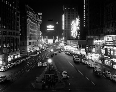 1930s OVERHEAD OF TIMES SQUARE LIT UP AT NIGHT WITH CARS LINING CURBS Stock Photo - Rights-Managed, Code: 846-02796709