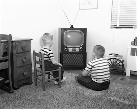 1950s BACK VIEW OF 2 BOYS IN STRIPED T-SHIRTS WATCHING TV Stock Photo - Rights-Managed, Code: 846-02796701