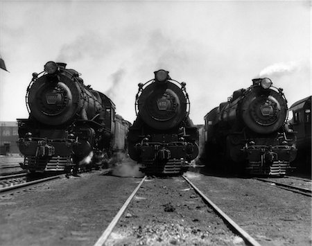 steam engine - 1930s HEAD-ON SHOT OF THREE STEAM ENGINE TRAIN LOCOMOTIVES ON TRACKS Stock Photo - Rights-Managed, Code: 846-02796735