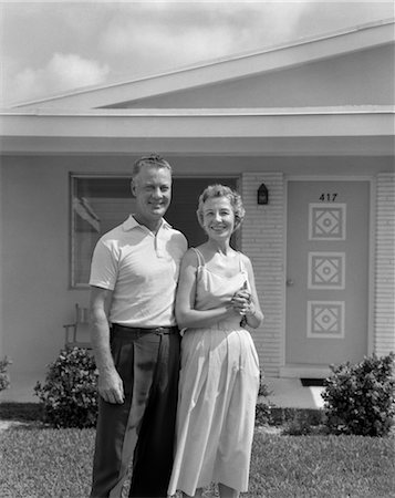 1950s SMILING OLDER MAN WOMAN SENIOR CITIZEN STANDING TOGETHER IN RETIREMENT HOME FRONT YARD Stock Photo - Rights-Managed, Code: 846-02796767