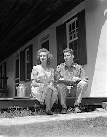 1940s COUPLE MAN WOMAN SITTING PORCH FARM HOUSE LOOKING OFF TO SIDE LEDGER BOOK MAN'S LAP SMALL MILK CONTAINER WOMAN PLAID DRESS Stock Photo - Rights-Managed, Code: 846-02796877