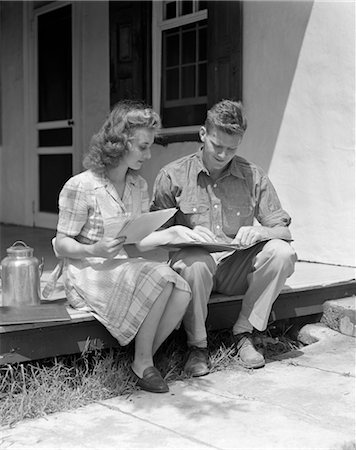 1940s COUPLE MAN WOMAN SITTING ON PORCH FARM HOUSE REVIEWING LEDGER PAPERS MILK METAL CONTAINER BY WOMAN Stock Photo - Rights-Managed, Code: 846-02796878