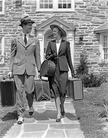 1930s 1940s SMILING COUPLE LEAVING HOME CARRYING LUGGAGE Stock Photo - Rights-Managed, Code: 846-02796928