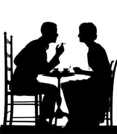 1920s COUPLE AT TABLE WITH TEACUPS MAN SMOKING CIGARETTE Stock Photo - Rights-Managed, Code: 846-02796932