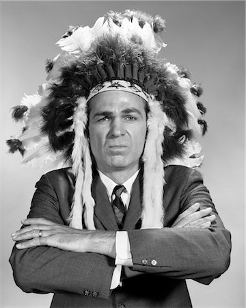 1960s PORTRAIT MAN WEARING INDIAN CHIEF FEATHERED HEADDRESS Stock Photo - Rights-Managed, Code: 846-02796956