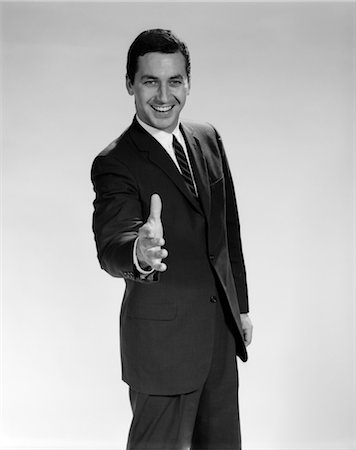 1960s MAN IN SUIT HOLDING HAND OUT TO SHAKE SMILING Stock Photo - Rights-Managed, Code: 846-02796966