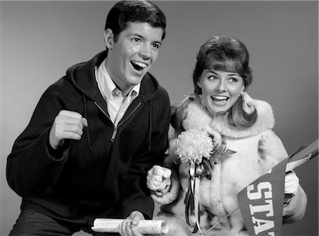 simsearch:846-02793283,k - 1960s PORTRAIT OF COUPLE AT GAME CHEERING SHE WITH PENNANT & CORSAGE Stock Photo - Rights-Managed, Code: 846-02797003
