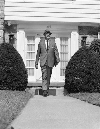 1950s MAN HOUSE SIDEWALK HAT SUIT WALKING TIE PORTFOLIO Stock Photo - Rights-Managed, Code: 846-02797018