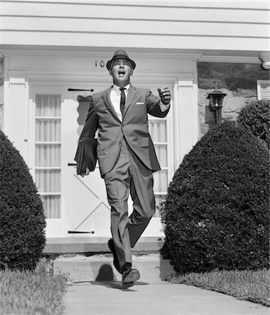 1950s MAN SUIT SIDEWALK TIE HAT WALKING STRIDE Stock Photo - Rights-Managed, Code: 846-02797019