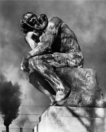 poison - 1970s STATUE OF RODING'S THINKER WEARING GAS MASK WITH SMOKE STACKS BILLOWING IN BACKGROUND Stock Photo - Rights-Managed, Code: 846-02797081