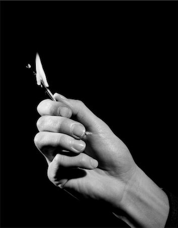 1950s MAN'S HAND HOLDING OUT WOODEN MATCH STICK BURNT ALMOST DOWN TO FINGERS Stock Photo - Rights-Managed, Code: 846-02797082