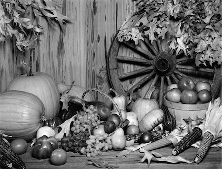 STILL LIFE OF FALL HARVEST FRUITS & VEGETABLES SET UP IN FRONT OF WAGON WHEEL Stock Photo - Rights-Managed, Code: 846-02797112