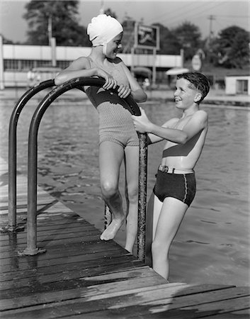 1940s GIRL AND BOY STANDING IN POOL WEARING BATHING SUITS Stock Photo - Rights-Managed, Code: 846-02797158