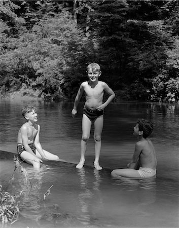 1940s THREE BOYS OUTDOOR IN SWIMMING HOLE Stock Photo - Rights-Managed, Code: 846-02797227