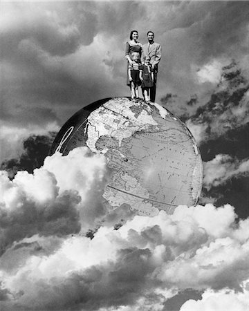 1950s SPECIAL EFFECT NUCLEAR FAMILY FOUR MAN WOMAN BOY GIRL MOM DAD TWO KIDS STAND ON TOP OF WORLD GLOBE EARTH CLOUDS Stock Photo - Rights-Managed, Code: 846-02797263