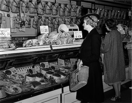 1940s WOMEN IN BUTCHER SHOP AT DISPLAY CASE OF MEATS Stock Photo - Rights-Managed, Code: 846-02797282