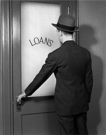 1930s 1940s MAN IN SUIT AND HAT OPENING DOOR MARKED LOANS Stock Photo - Rights-Managed, Code: 846-02797300