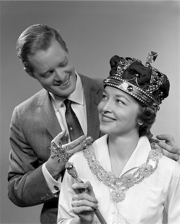 1950s MAN HOLDING NECKLACE ON WOMAN WEARING CROWN AND HOLDING SCEPTER Stock Photo - Rights-Managed, Code: 846-02797369