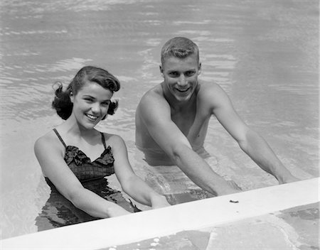 1950s COUPLE IN SWIMMING POOL Stock Photo - Rights-Managed, Code: 846-02797382