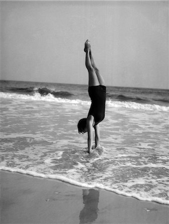 1920s WOMAN DOING A HANDSTAND IN OCEAN Stock Photo - Rights-Managed, Code: 846-02797402