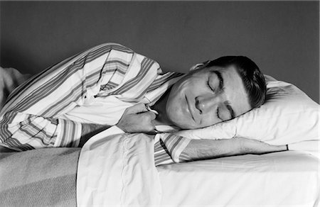 1960s MAN IN STRIPED PAJAMAS ASLEEP IN BED Stock Photo - Rights-Managed, Code: 846-02797447