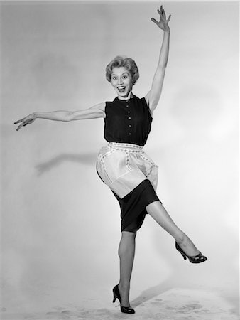 1950s WOMAN IN APRON HOUSEWIFE DANCING KICKING Stock Photo - Rights-Managed, Code: 846-02797452