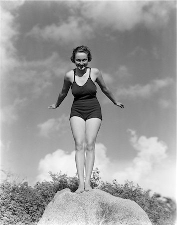 1930s WOMAN IN BATHING SUIT STANDING ON ROCK ABOUT TO DIVE Stock Photo - Rights-Managed, Code: 846-02797489