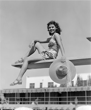 1930s 1940s WOMAN HOLDING HAT POSING DIVING BOARD SWIM SUIT POOL TRAVEL VACATION SWIMMING HOTEL MIAMI FLORIDA Stock Photo - Rights-Managed, Code: 846-02797567