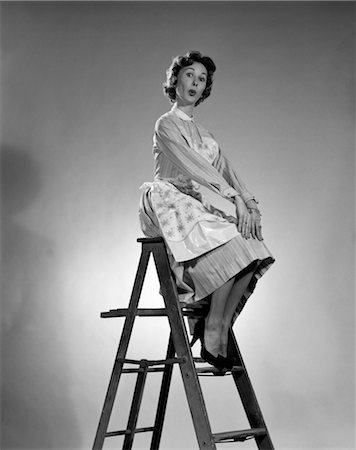 1950s WOMAN IN APRON SITTING ON LADDER WITH EXAGGERATED EXPRESSION Stock Photo - Rights-Managed, Code: 846-02797561