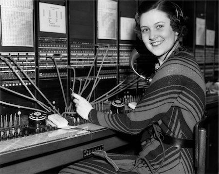 1930s WOMAN TELEPHONE OPERATOR AT SWITCHBOARD Stock Photo - Rights-Managed, Code: 846-02797600