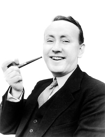 1940s PORTRAIT MAN HOLDING PIPE IN HIS HAND SMILING AT CAMERA DRESSED IN SUIT AND TIE SMOKING BAD HABIT TOBACCO Stock Photo - Rights-Managed, Code: 846-02797651