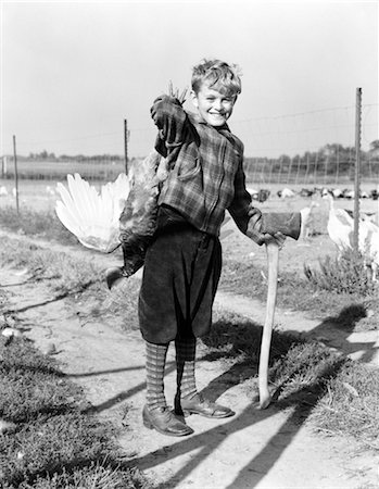 1940s BOY IN PLAID JACKET AND KNICKERS SMILING HOLDING LIVE TURKEY OVER SHOULDER AND AXE Stock Photo - Rights-Managed, Code: 846-02797660