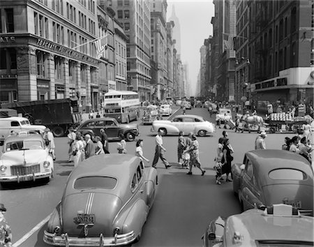 1940s 1950s STREET SCENE CROWDS TRAFFIC INTERSECTION FIFTH AVENUE & 14 STREET MANHATTAN NY NEW YORK CITY Stock Photo - Rights-Managed, Code: 846-02797690