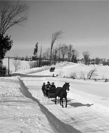 1960s FAMILY DRIVING DOWN RURAL ROAD IN ONE-HORSE SLEIGH Stock Photo - Rights-Managed, Code: 846-02797820
