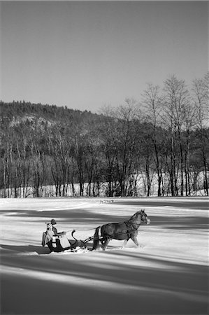 1970s COUPLE RIDING IN CUTTER SLEIGH BEHIND A SINGLE HORSE IN KNEE DEEP SNOW NORTH CONWAY VERMONT USA Stock Photo - Rights-Managed, Code: 846-02797830