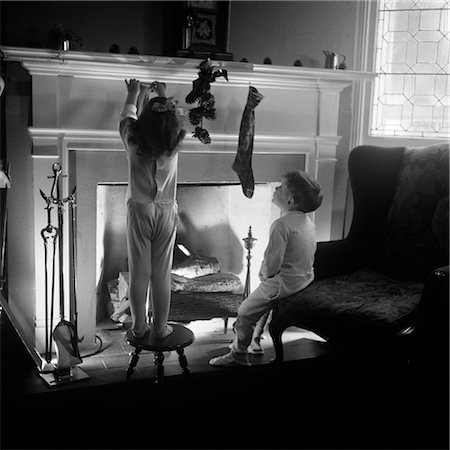 pantyhose kid - 1940s BOY GIRL HANGING CHRISTMAS STOCKINGS AT FIREPLACE Stock Photo - Rights-Managed, Code: 846-02797855