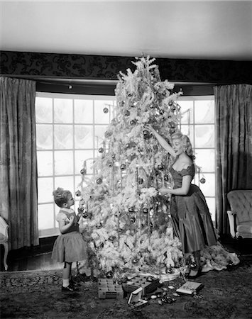 1950s MOTHER AND DAUGHTER DECORATING CHRISTMAS TREE ORNAMENTS Stock Photo - Rights-Managed, Code: 846-02797887