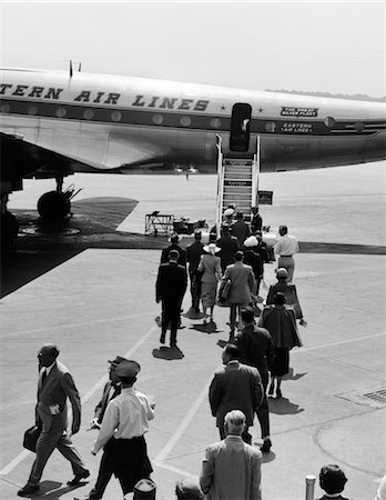1950s 1960s AIRPLANE BOARDING PASSENGERS WALKING ACROSS TARMAC Stock Photo - Rights-Managed, Code: 846-02791694