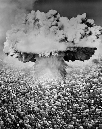 1950s 1960s ATOMIC BOMB SYMBOLIC MONTAGE MUSHROOM CLOUD OVER A VERY LARGE CROWD OF PEOPLE FACING THE EXPLOSION Stock Photo - Rights-Managed, Code: 846-02791724