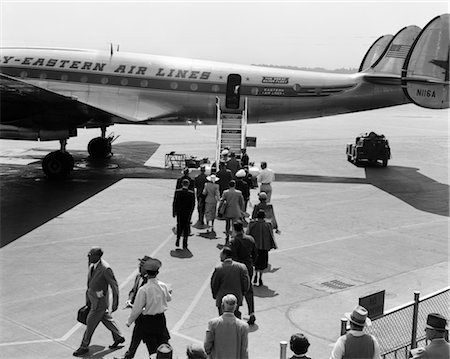 1960s PASSENGERS BOARDING PROP PLANE LADDER TARMAC TRAVEL VACATION AIRPORT EASTERN AIR LINES Stock Photo - Rights-Managed, Code: 846-02791743