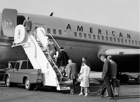1960s PASSENGERS BOARDING AMERICAN AIRLINES ASTROJET BY WAY OF SHORT STAIRWAY RAISED FROM BED OF PICKUP TRUCK Stock Photo - Rights-Managed, Code: 846-02791760