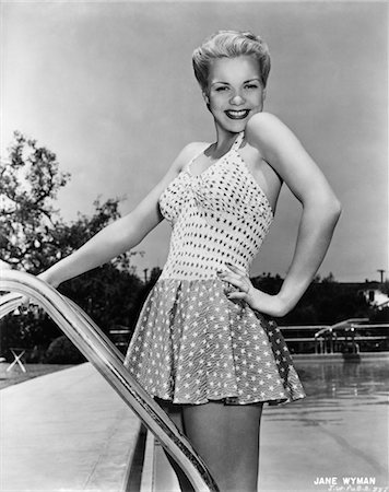 1940s ACTRESS JANE WYMAN POSING IN BATHING SUIT ON SWIMMING POOL LADDER Stock Photo - Rights-Managed, Code: 846-02791818