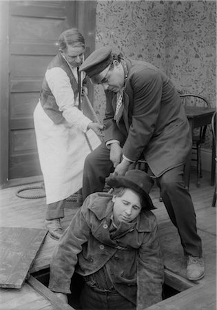 saloon - TWO MEN PULLING COWBOY UP FORM UNDERNEATH TRAPDOOR IN FLOOR Stock Photo - Rights-Managed, Code: 846-02791836