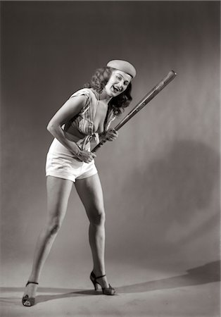 1940s 1950s SMILING WOMAN WEARING HALTER TOP HOLDING BASEBALL BAT Stock Photo - Rights-Managed, Code: 846-02791864