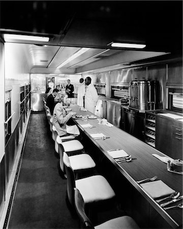 PATRONS AND STAFF INSIDE DINING CAR ON TRAIN Stock Photo - Rights-Managed, Code: 846-02791878