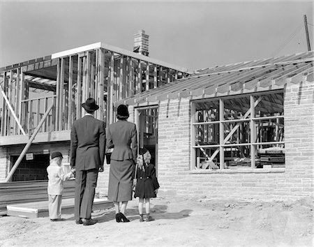 1950s FAMILY LOOKING AT NEW HOME UNDER CONSTRUCTION Stock Photo - Rights-Managed, Code: 846-02791908