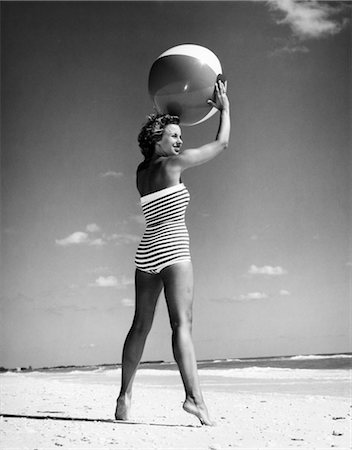 1960s WOMAN IN STRIPES SWIM SUIT BATHING HOLDING BEACH BALL STANDING ON TIP TOES Stock Photo - Rights-Managed, Code: 846-02791960